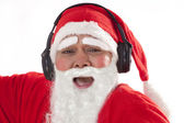 Santa Claus listening to music — Stock Photo