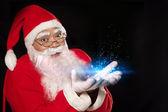 Santa Claus performing magic — Stock Photo