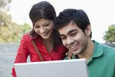 Students using laptop — Stock Photo