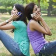 Young women using cell phones — Stock Photo #46445405