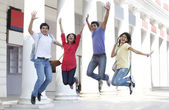 College students jumping — Stock Photo