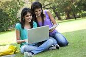 Young women using laptop — Stock Photo
