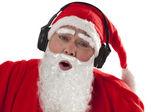 Santa Claus enjoying music — Stock Photo