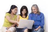 Multi generational family talking while shopping online — Stock Photo