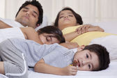 Family sleeping on bed — Stock Photo
