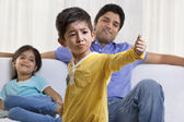 Boy acting in front of father and sister — Stock Photo