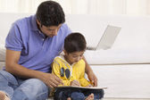 Father assisting his son in drawing — Stock Photo