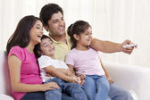Cheerful family watching TV — Stock Photo
