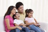 Cheerful family watching TV — Stock Photo