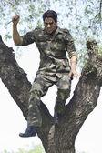 Aggressive soldier holding bayonet — Stock Photo