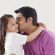 Girl kissing her father — Stock Photo #46480657