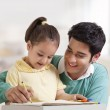Father helping her daughter in drawing — Stock Photo #46482583