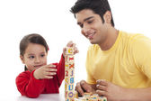 Little girl and father playing block game — Stock Photo