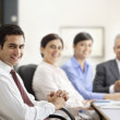 Executives with businesspeople — Stock Photo #47436831