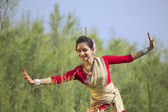 Woman performing Bihu dance — Stock Photo