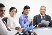 Executives with businesspeople — Stock Photo