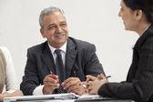 Mature businessman talking — Stock Photo