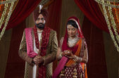 Sikh bride and groom on indian wedding ceremony — Stock Photo