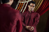 Young Indian groom getting dressed — Stock Photo