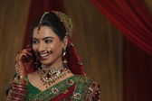 Indian bride talking on cell phone — Stock Photo