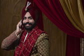 Sikh groom talking on mobile phone — Stock Photo