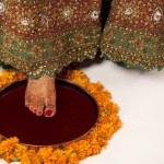 Постер, плакат: Close up of brides foot on a thali
