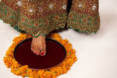 Close-up of brides foot on a thali — Stock Photo
