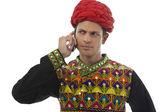 Male dandiya dancer talking on the phone — Stock Photo