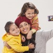 Happy family photographing themselves — Stock Photo #47498539