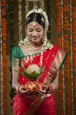 Young bride holding kalash — Stock Photo
