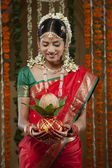 Young bride holding kalash — Stock Photo