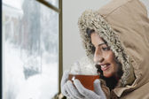 Woman in warm clothes holding tea cup — Foto de Stock