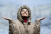 Young woman enjoying snow fall — Stock Photo