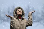 Young woman enjoying snow fall — Stock Photo
