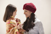 Woman with her daughter — Stock Photo