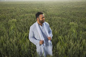 Indian man standing in field — Stock Photo