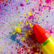 Squirt gun on colorful powder paint — Stock Photo #51098091
