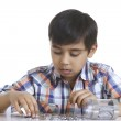 Boy counting coins at table — Stock Photo #51099125
