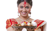 Bengali woman holding a puja thali — Stock Photo