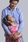 Young man embracing daughter — Stock Photo