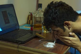 Young man snorting drugs — Stock Photo