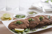 Cutlets arranged in plate — Stock Photo