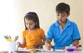 Siblings coloring — Stock Photo