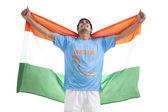 Male hockey player holding Indian flag — Stock Photo