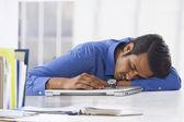 Young businessman sleeping on laptop — Stock Photo