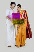 South Indian couple with gifts — Stock Photo