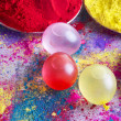 Water bombs and colorful powder during Holi festival — Stock Photo #51100969