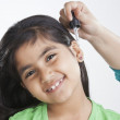 Little girl getting drops put in ear — Stock Photo #51101323