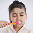 Little girl brushing her teeth — Stock Photo #51101377
