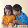 Brother and sister playing with blocks — Stock Photo #51101487